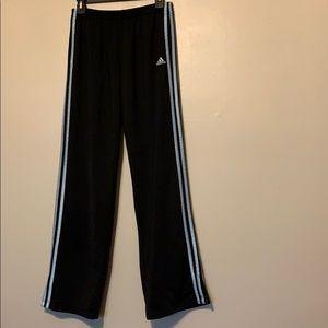 Black Adidas track pants with light blue stripes
